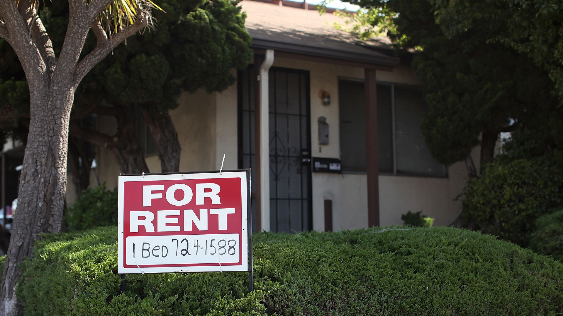 """A """"for rent"""" sign is posted in front of a house on June 15, 2012 in Richmond, California."""