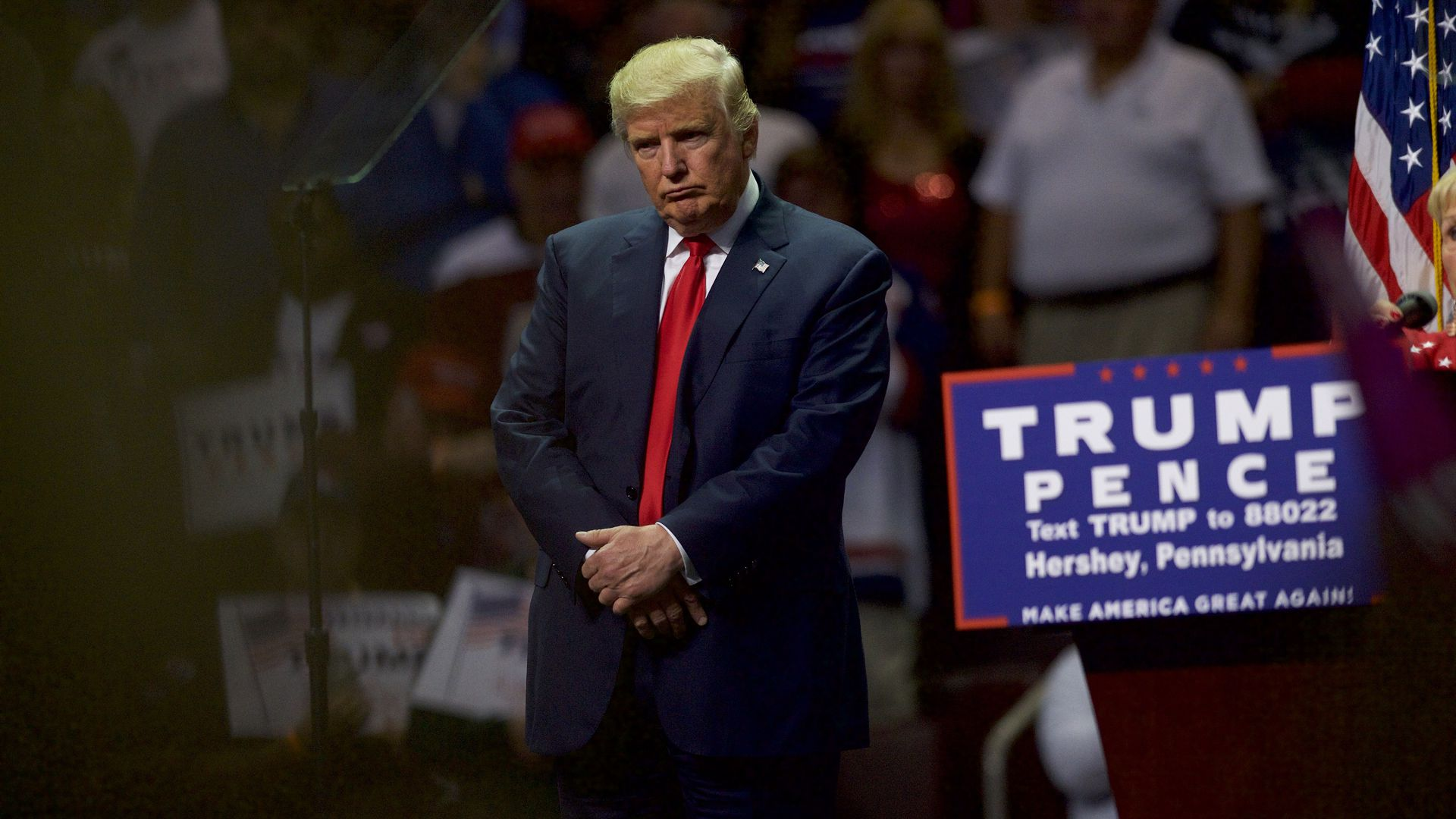 Donald Trump frowns at a campaign rally