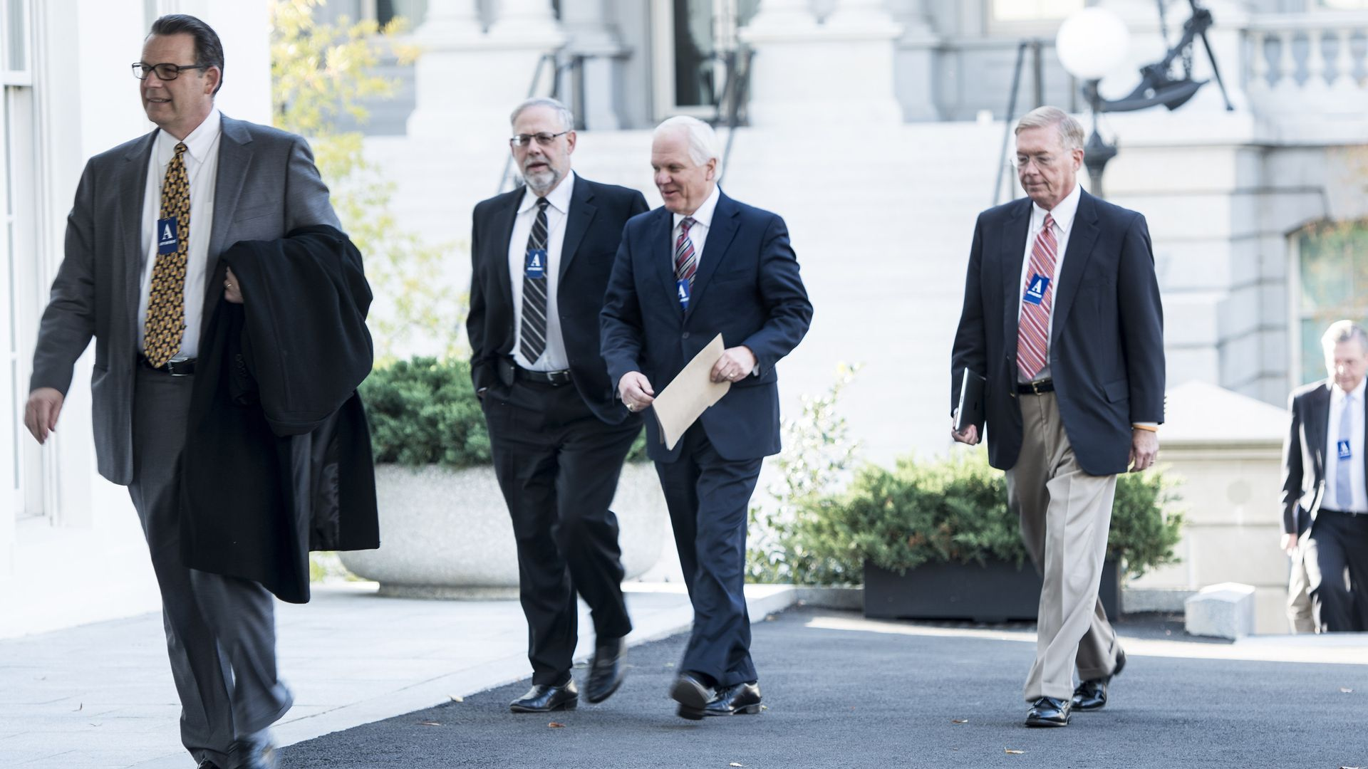 Joseph Swedish and other health insurance executives walk into the White House.