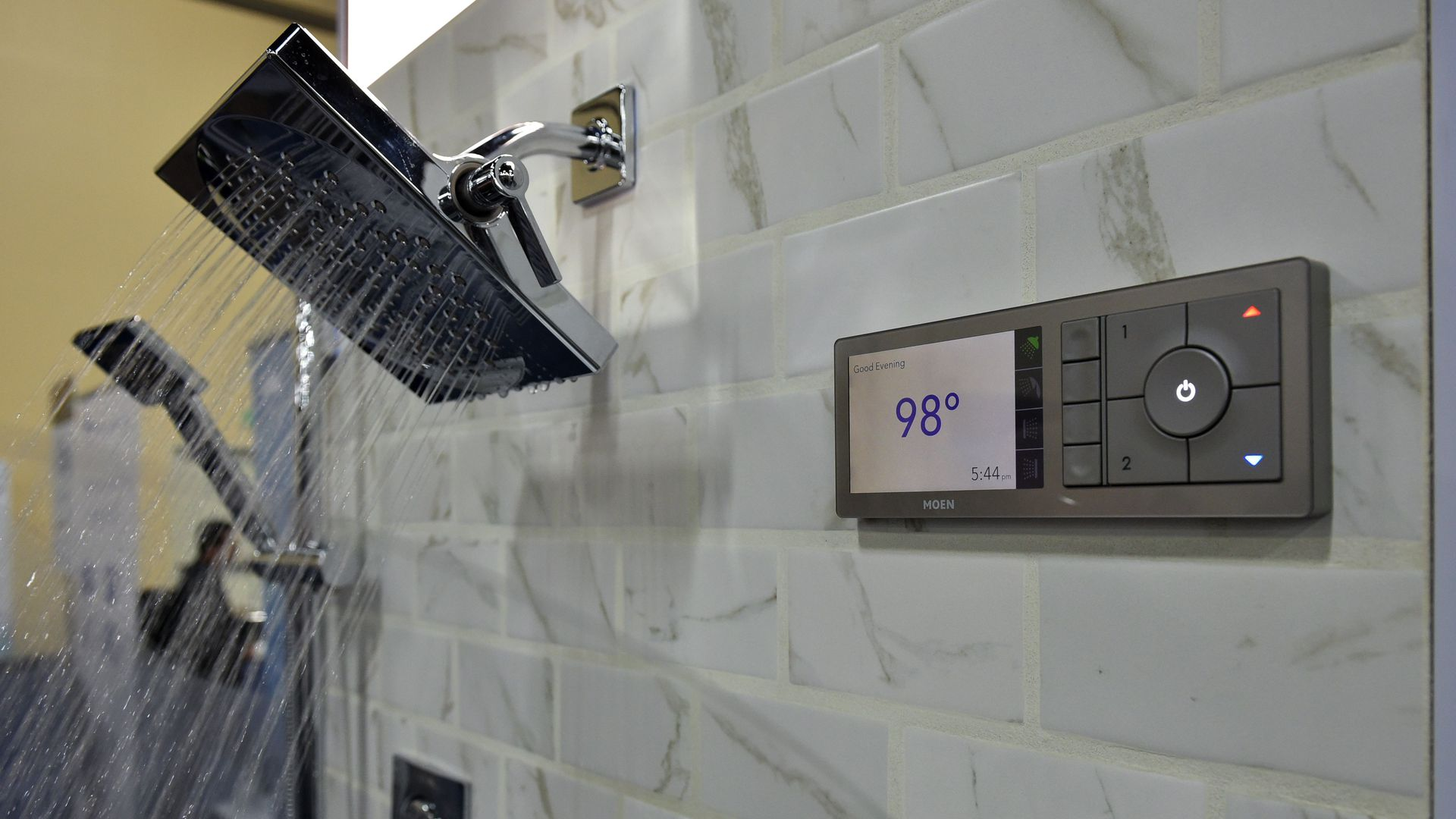 A voice enabled shower streams water