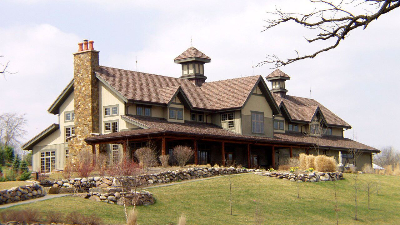 Craftsman-style mansion with expansive front porch.
