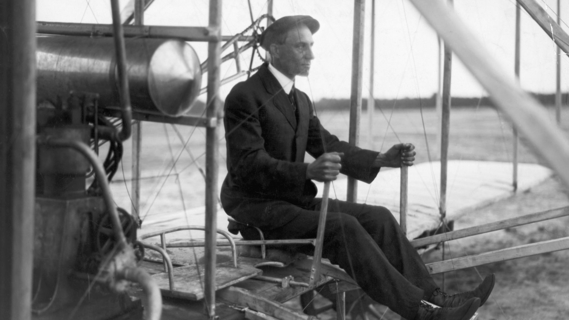 Wilbur Wright in his airplane during flight in France, 1908.