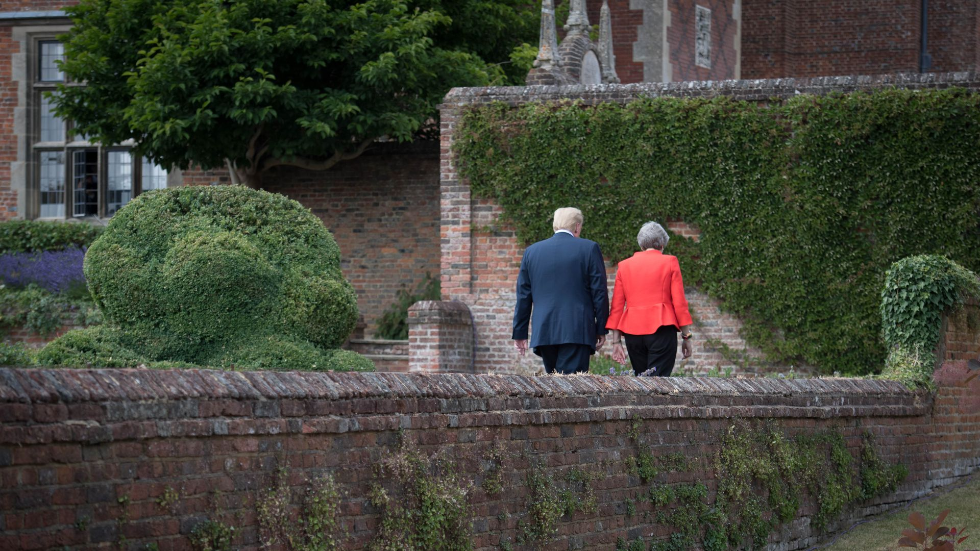 Donald Trump and Theresa May walking together