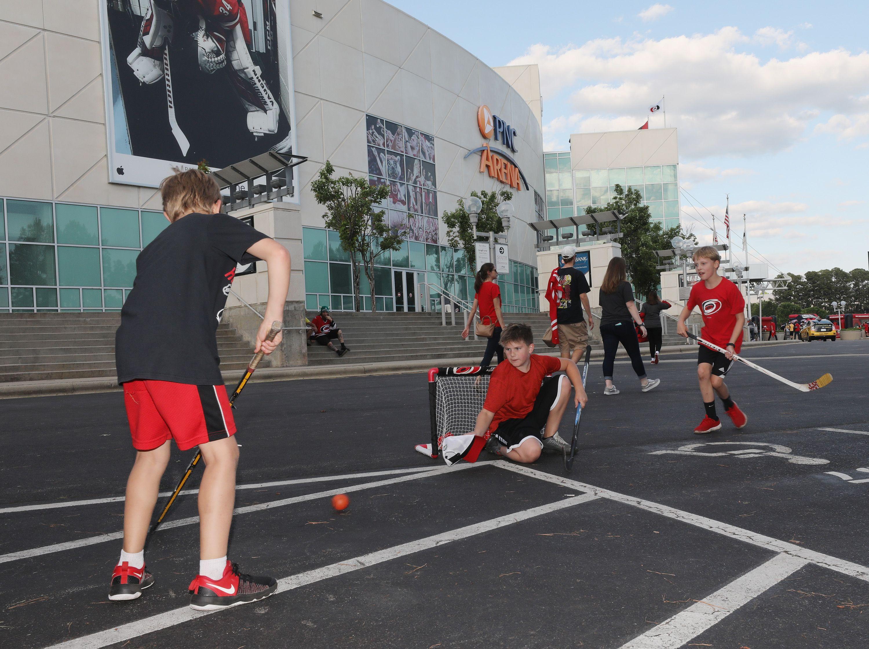 Kids playing hockey outside the stadium