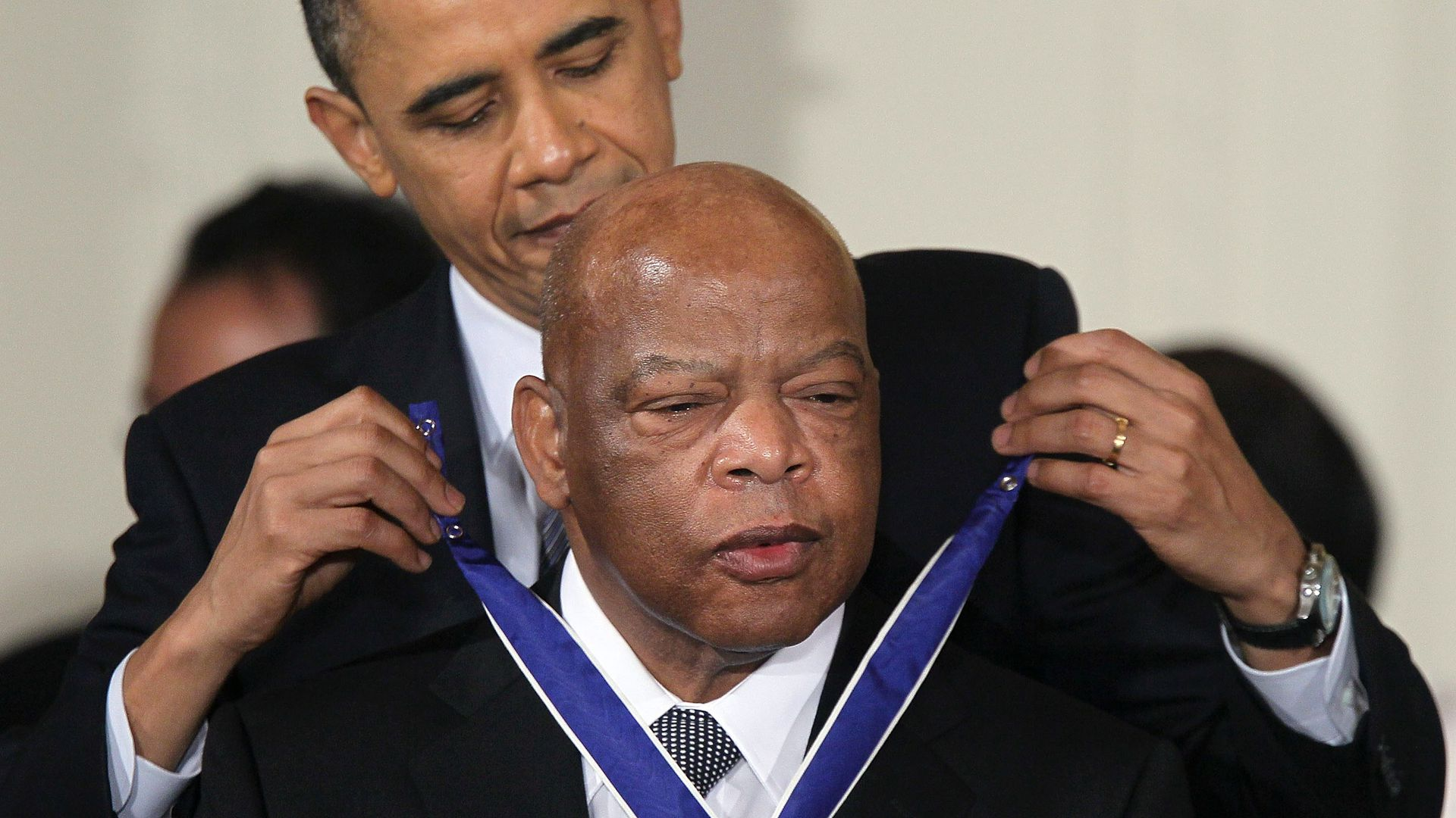 Rep. John Lewis (D-GA) (R) is presented with the 2010 Medal of Freedom by President Barack Obama during an East Room event at the White House February 15, 2011
