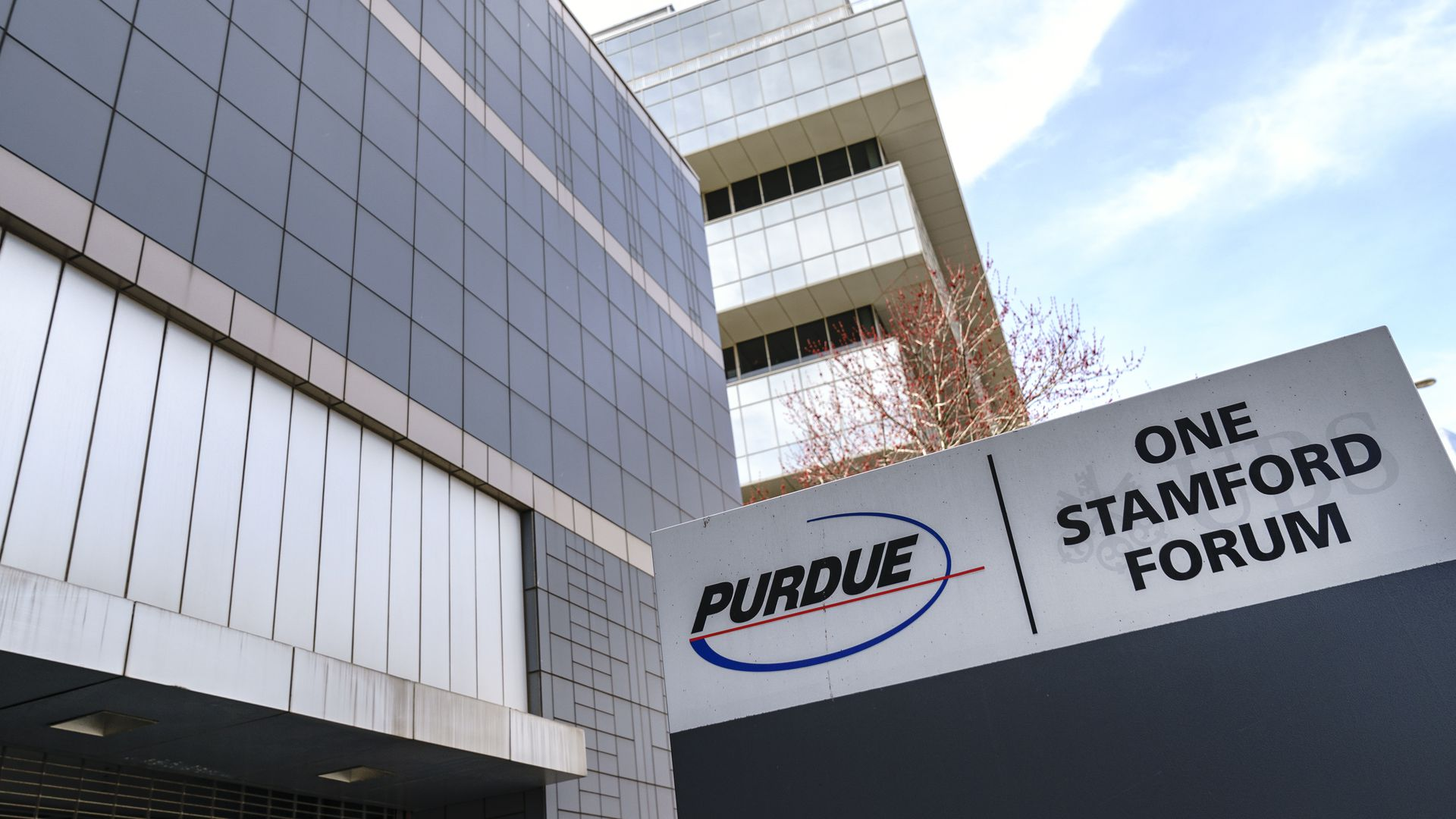 Purdue logo and sign outside of a headquarters building.