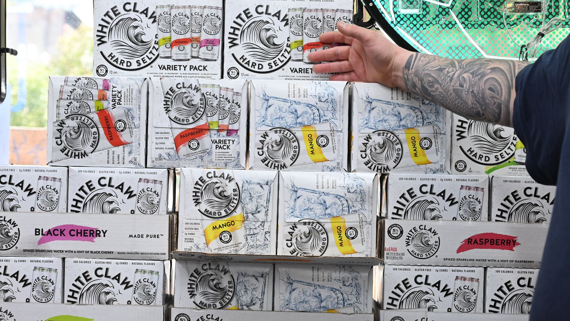 A stack of cases of White Claw