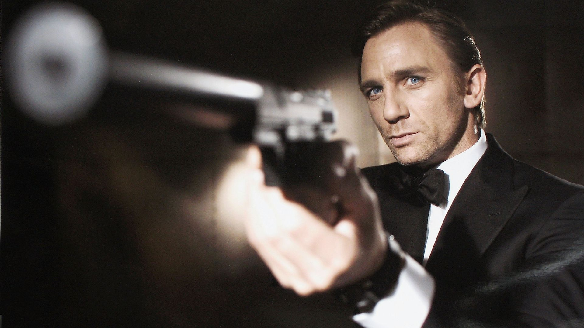 James Bond, with gun