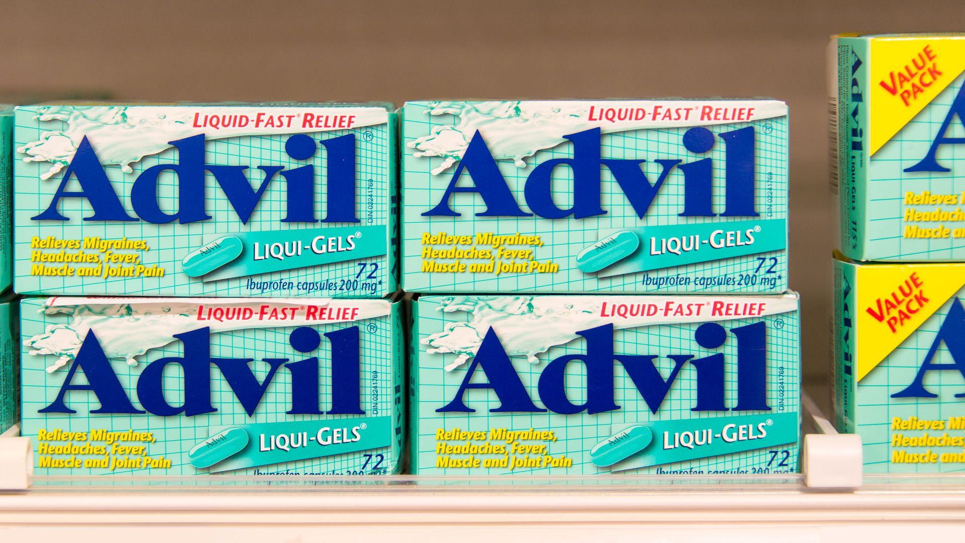 Advil packages sit on a shelf.