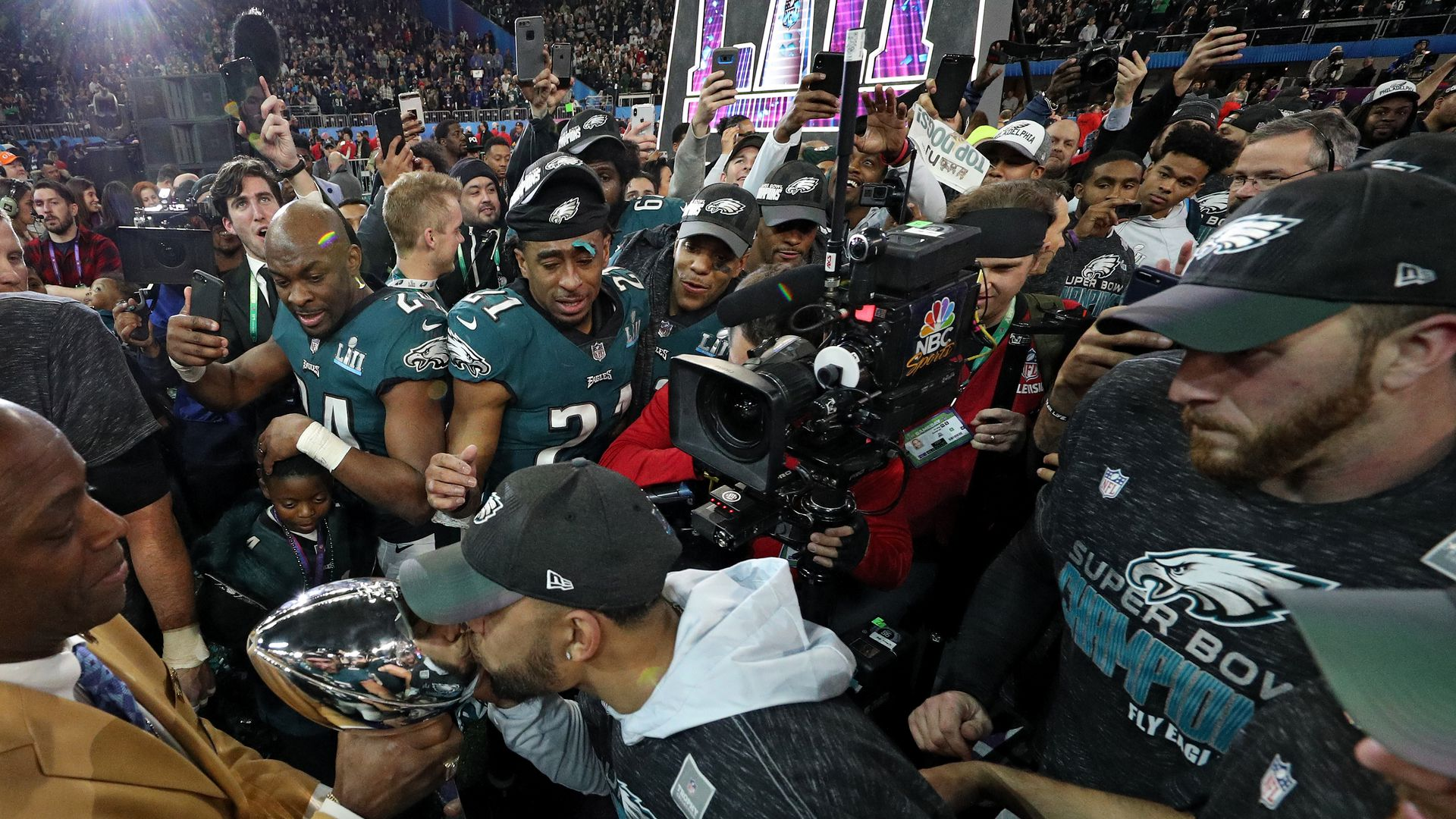 Philadelphia Eagles players kiss the Lombardi Trophy after defeating the New England Patriots in Super Bowl LII in February.