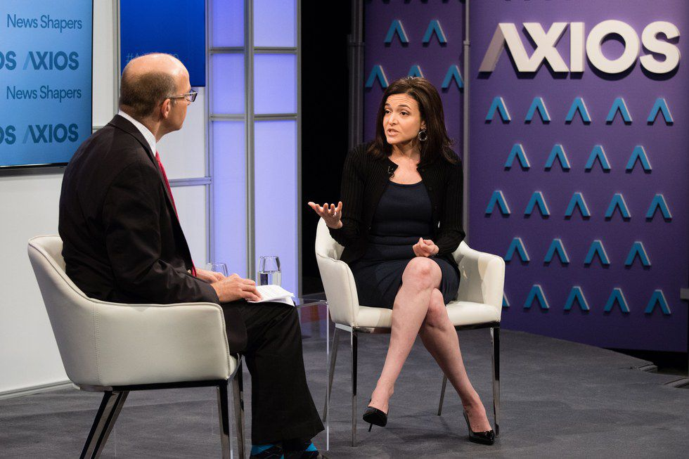Sheryl Sandberg speaking with Mike Allen on stage