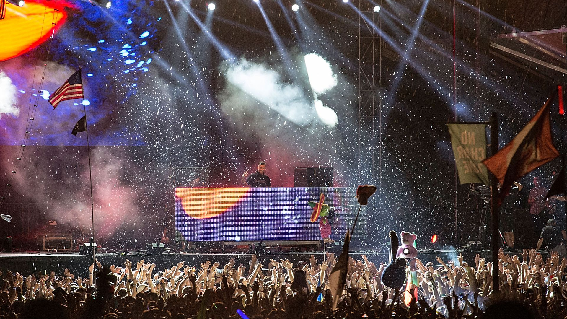 Kaskade performs in the rain during the 2013 ACL Festival