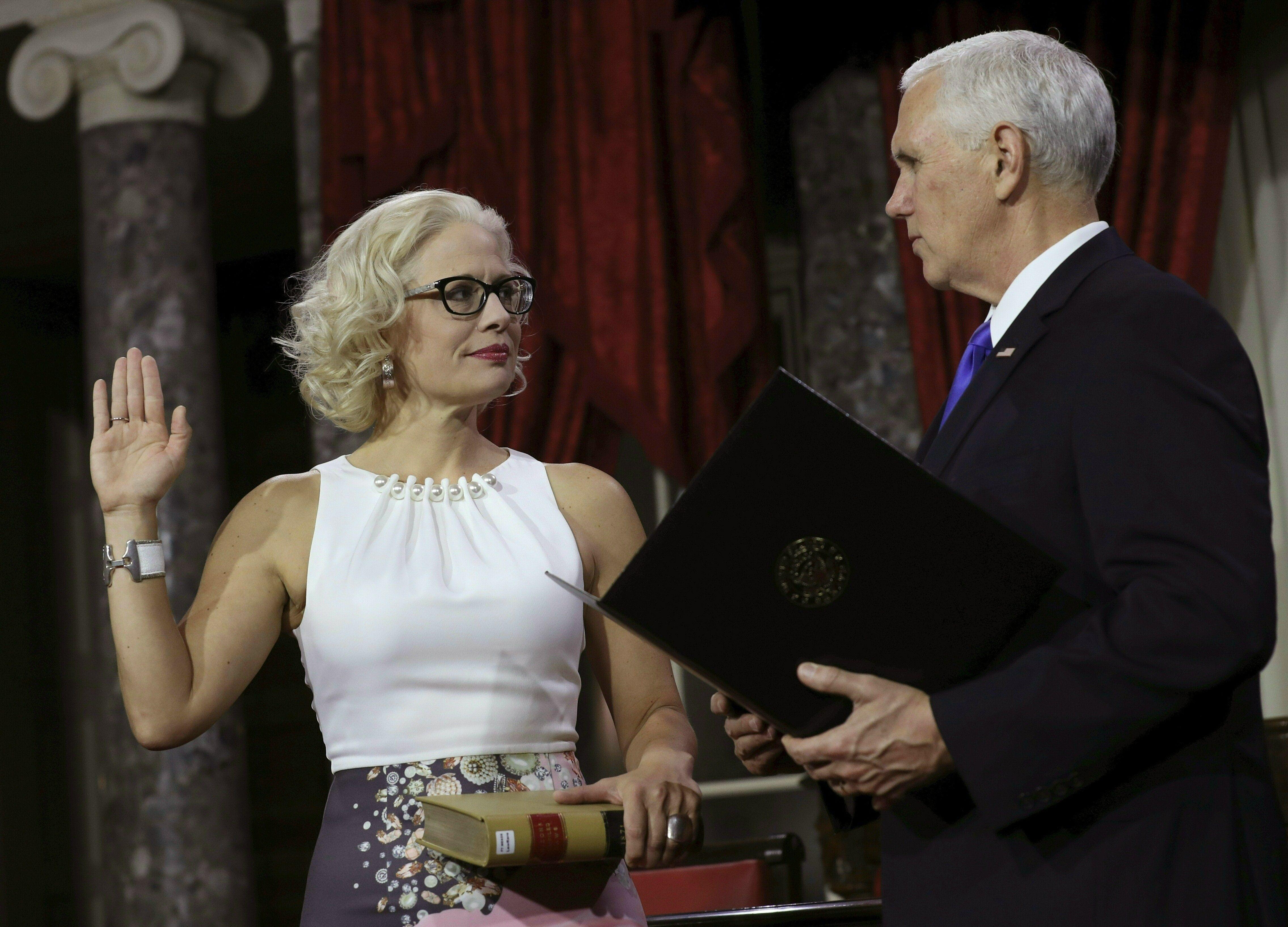 Kirsten Sinema sworn in by Mike Pence.