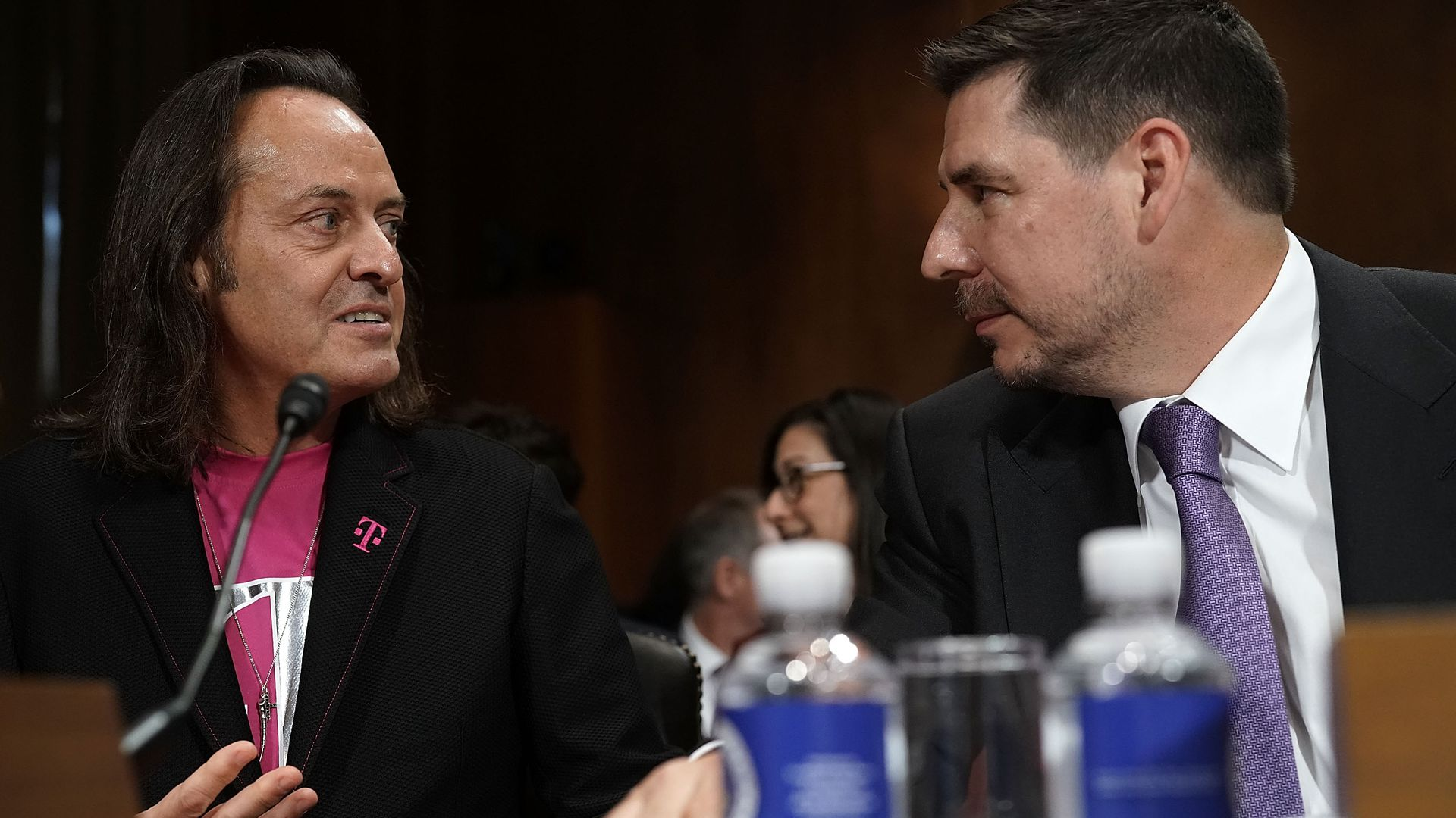The chief executives of T-Mobile and Sprint