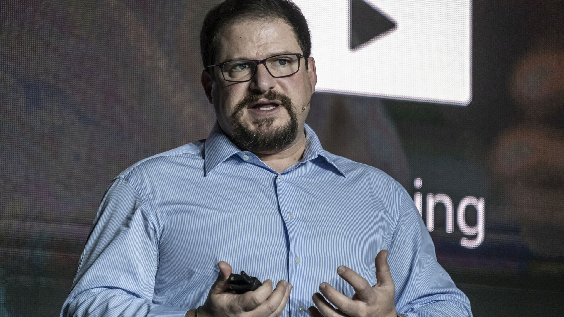 A man presents in a blue collared shirt