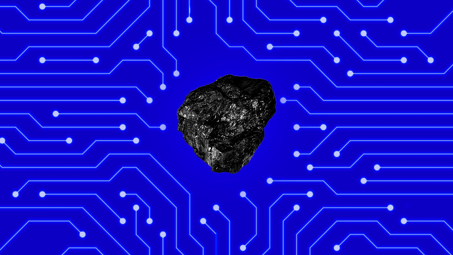 Image of a piece of coal against a backdrop of circuits