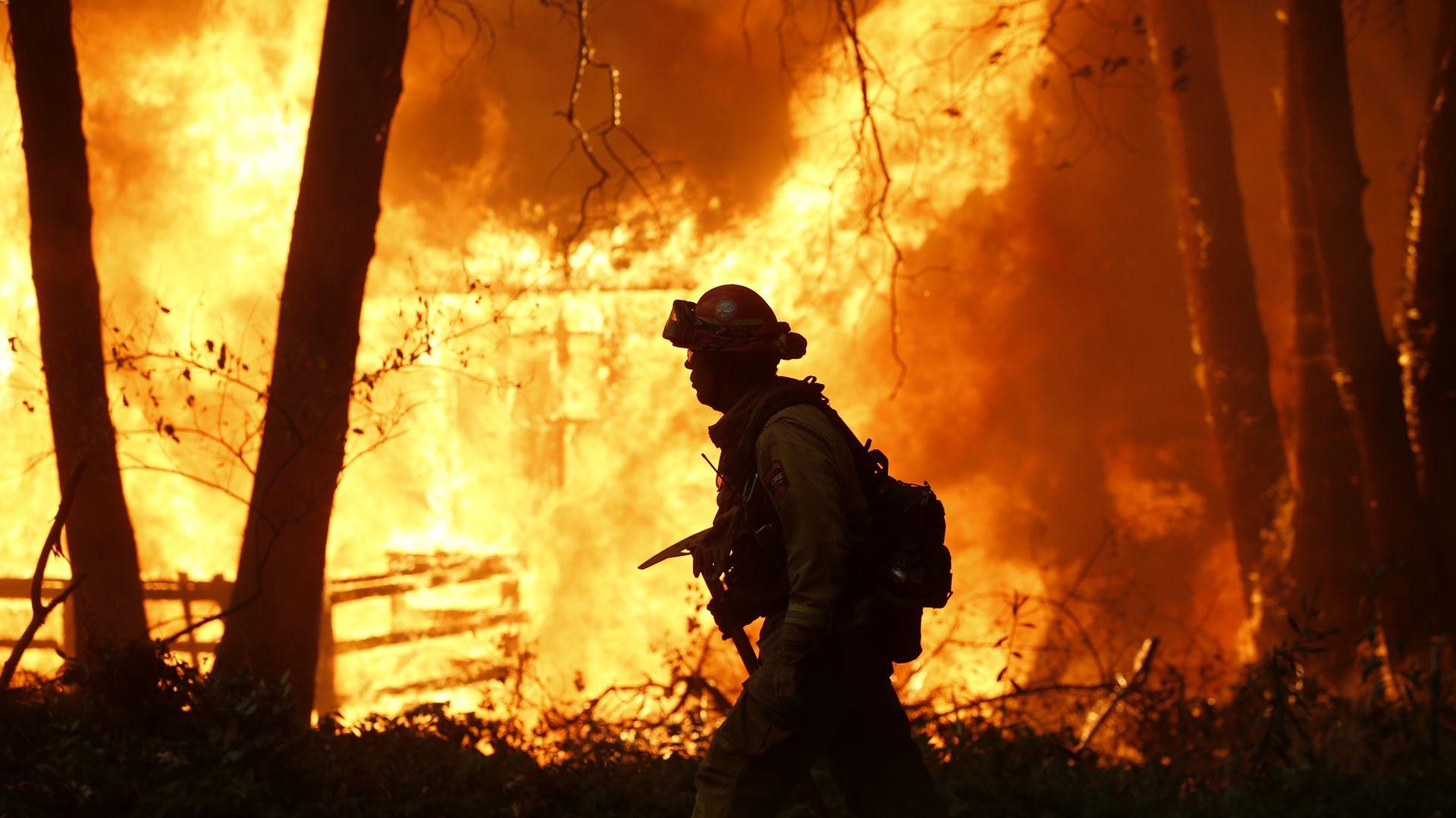NOVEMBER 09: Sacramento Metropolitan firefighters battle the Camp Fire in Magalia, Calif., Friday, November 9, 2018.