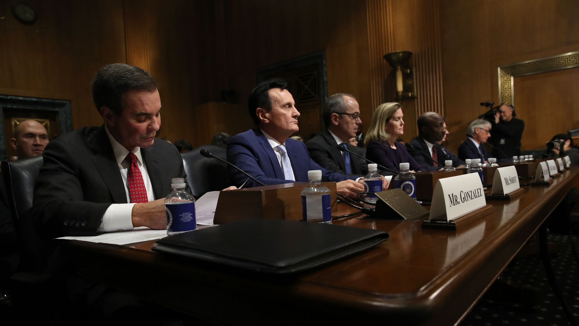 The executives 7 pharmaceutical companies sit at a table in front of the Senate.