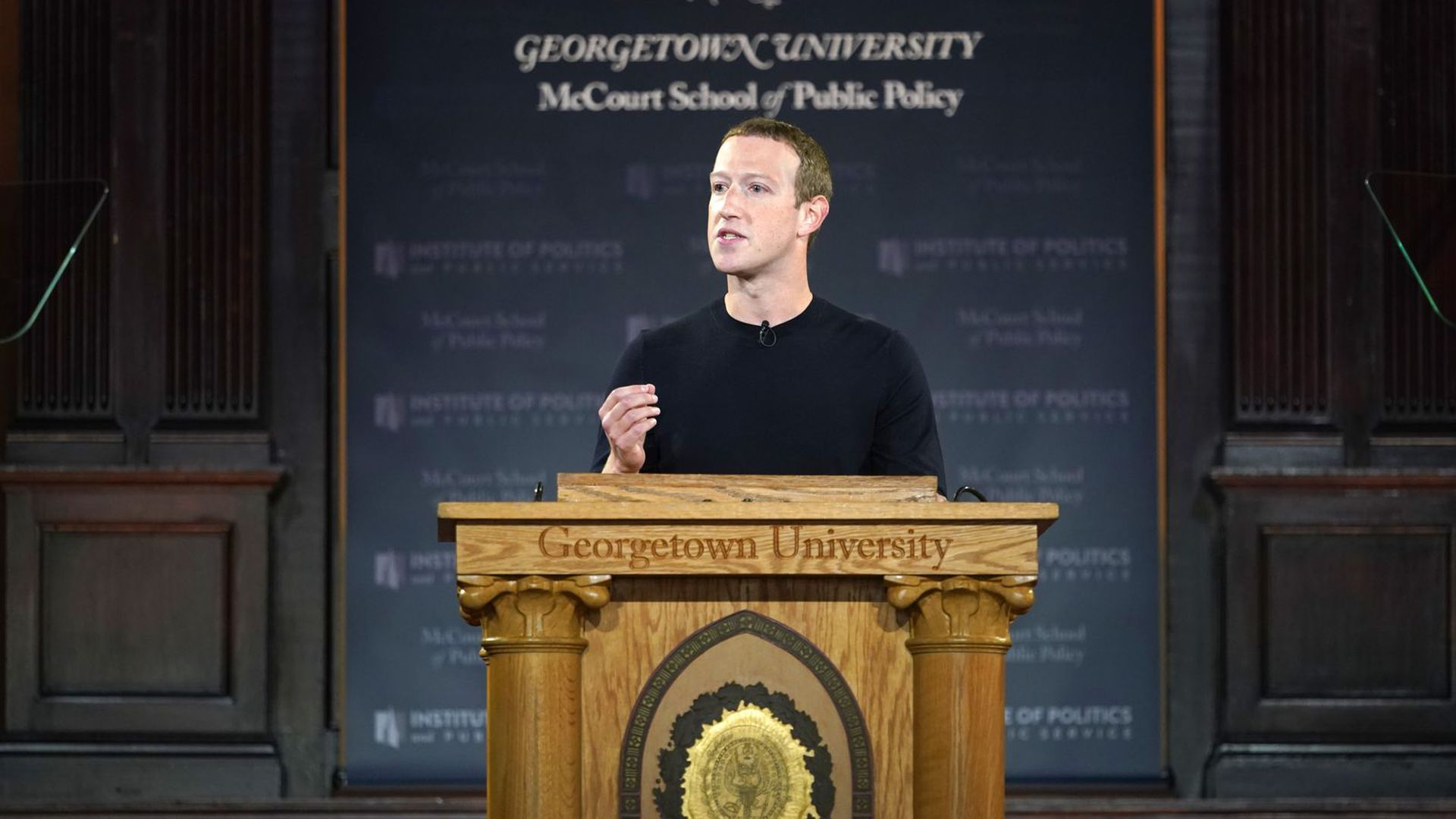 Photo of Facebook CEO Mark Zuckerberg speaking at a Georgetown University lectern