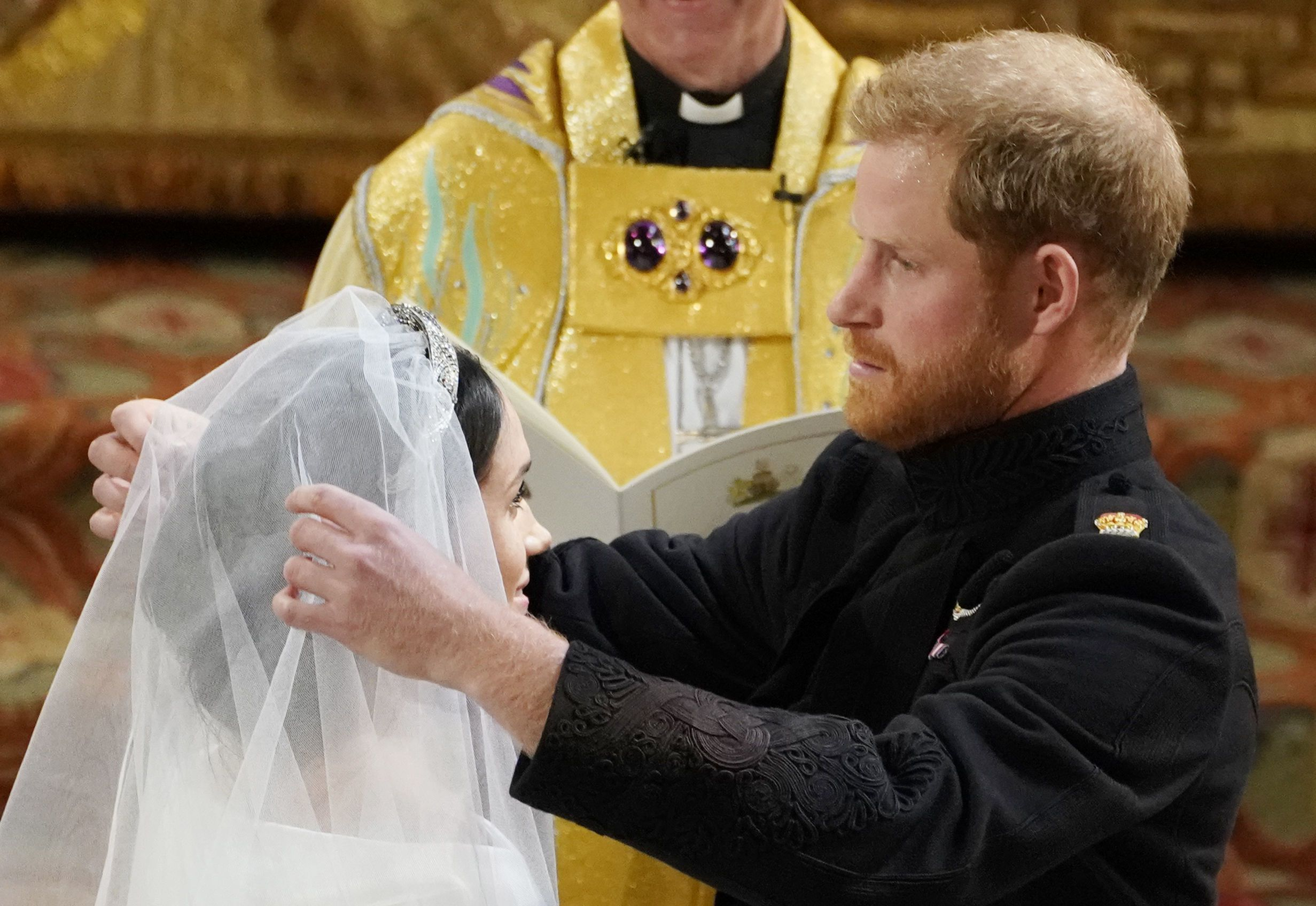 Prince Harry lifts Meghan Markle's veil.