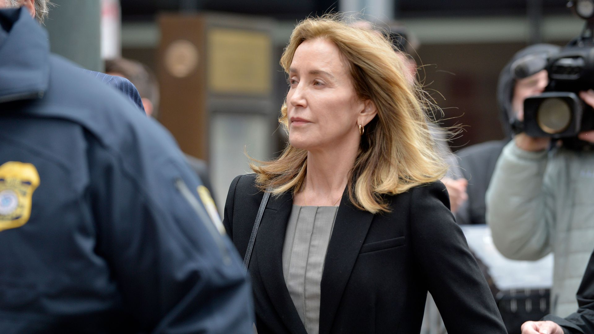 Actress Felicity Huffman is escorted by Police into court on May 13, 2019 in Boston, Massachusetts.