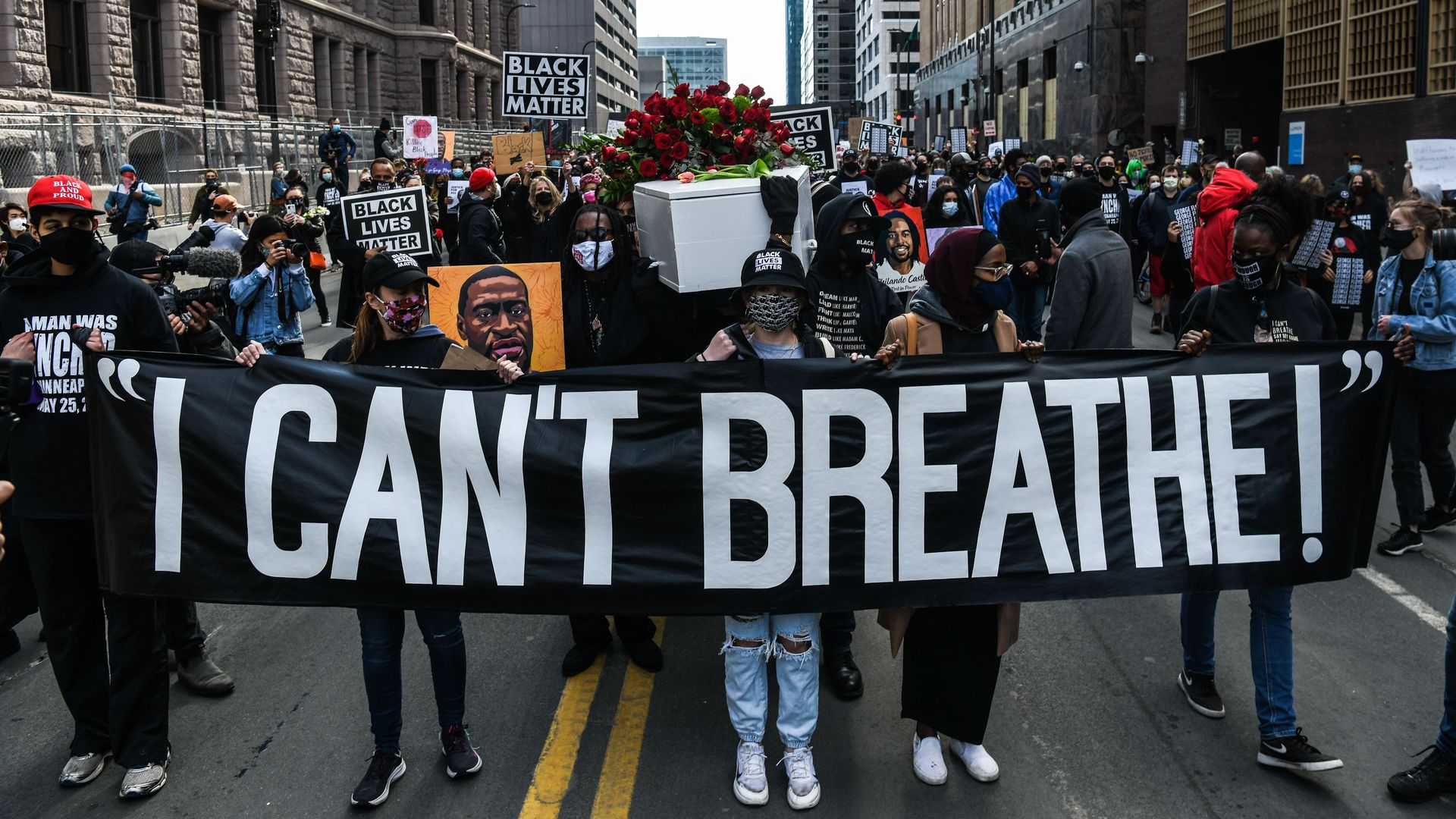 Demonstrators march outside the Hennepin County Government Center  in Minneapolis, Minnesota.