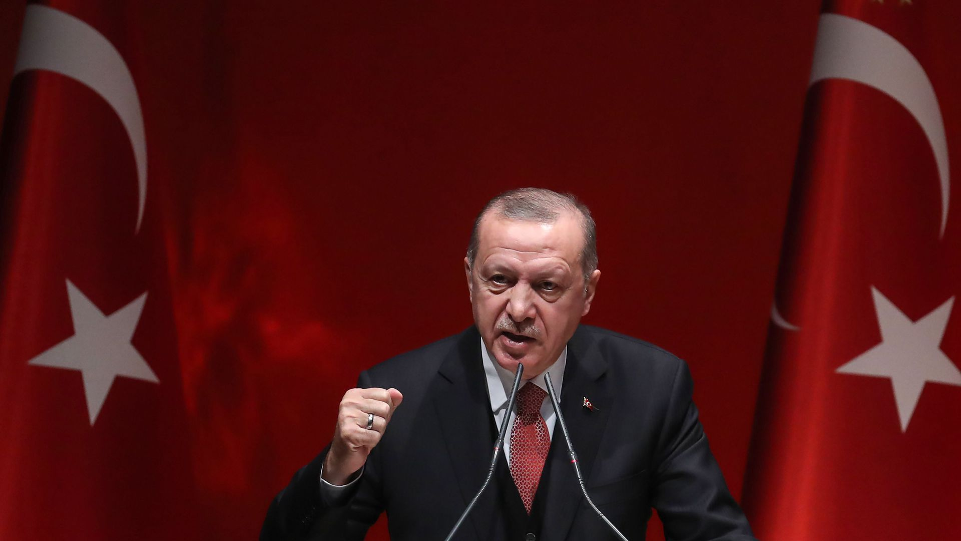 Turkey's president Recep Tayyip Erdogan delivers a speech.