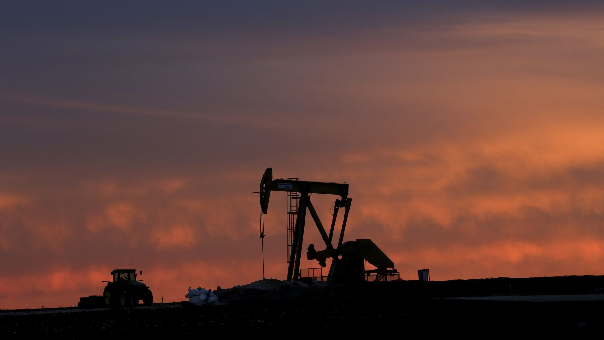 A shale oil pump at sunset