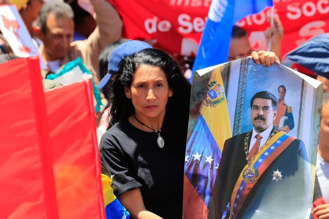 Venezuelan President Nicolas Maduro's supporters gather holding banners and flags during a demonstration in support of Nicolas Maduro, in Caracas, Venezuela.