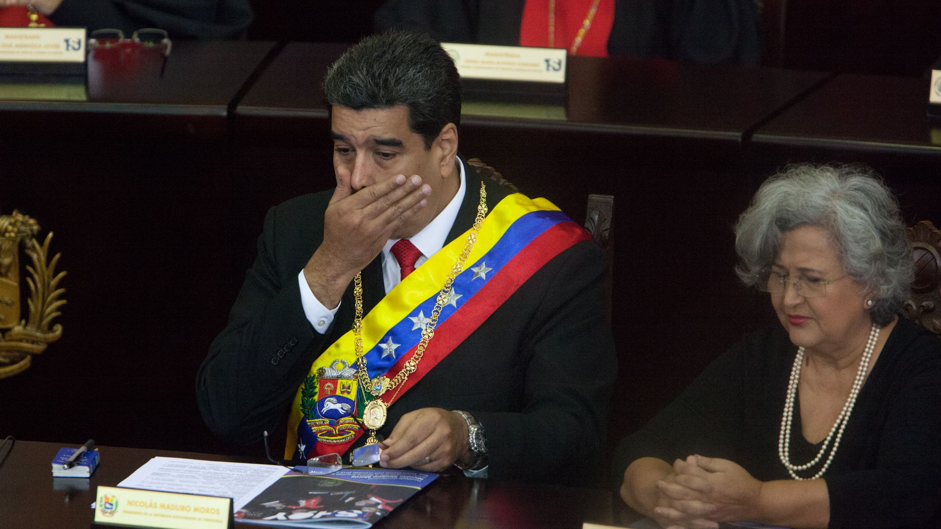 Nicolas Maduro covers his mouth and looks shocked.
