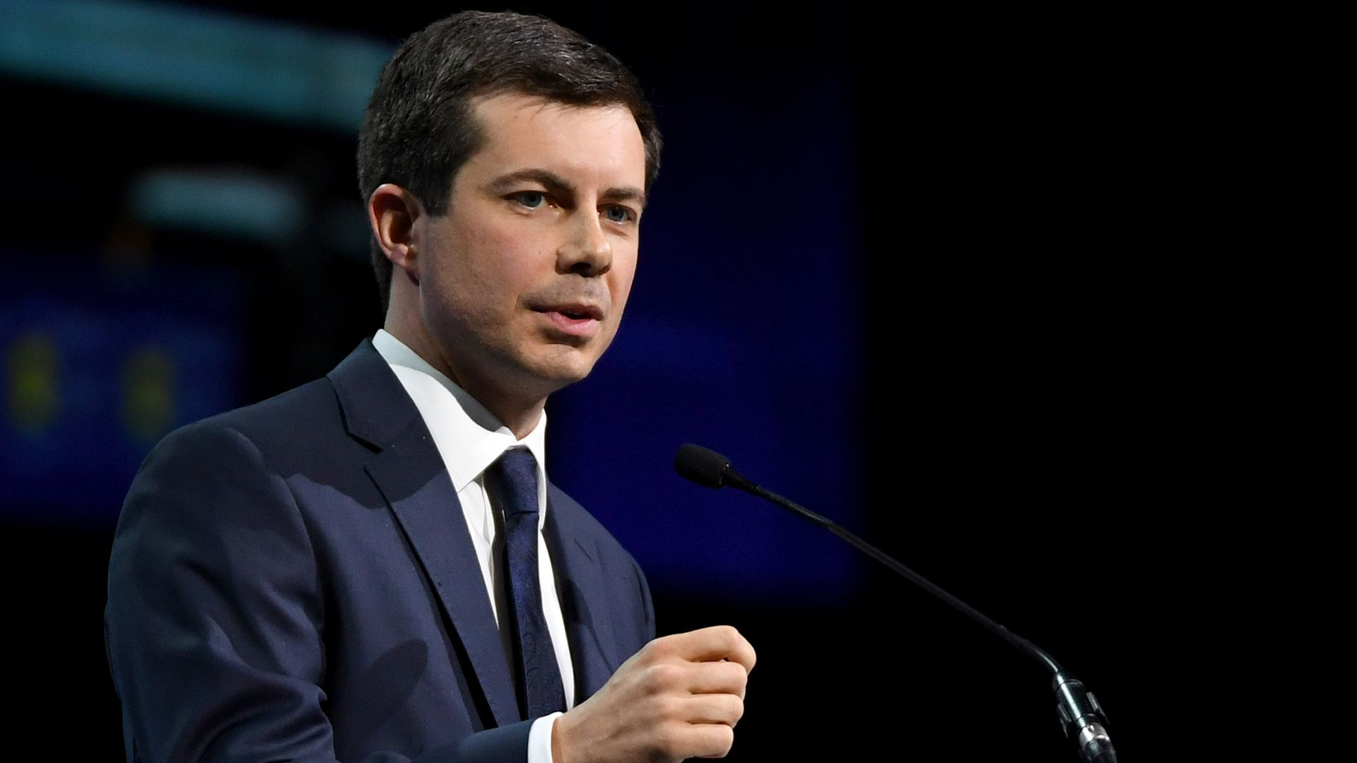 Pete Buttigieg gestures during a speech.