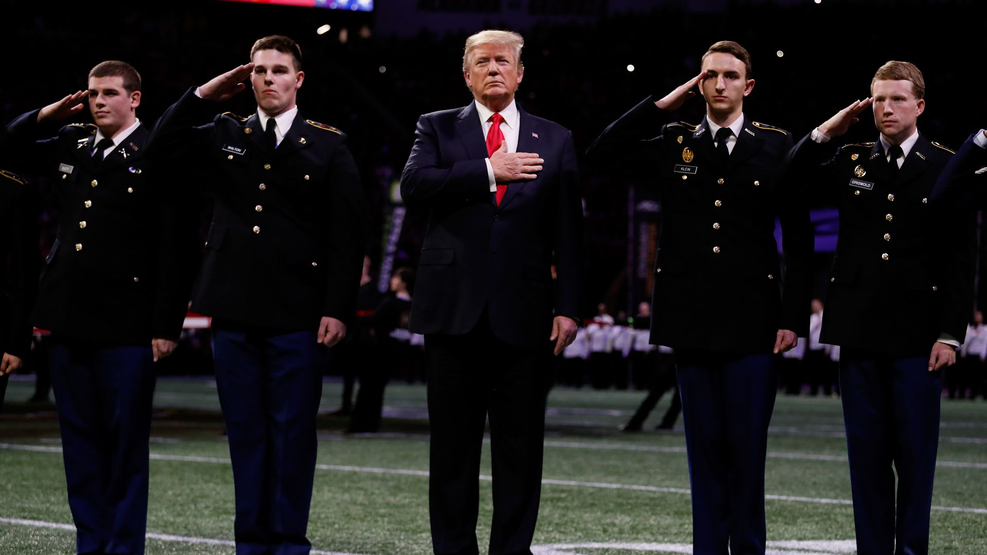 President Trump with his hand over his heart during the national anthem