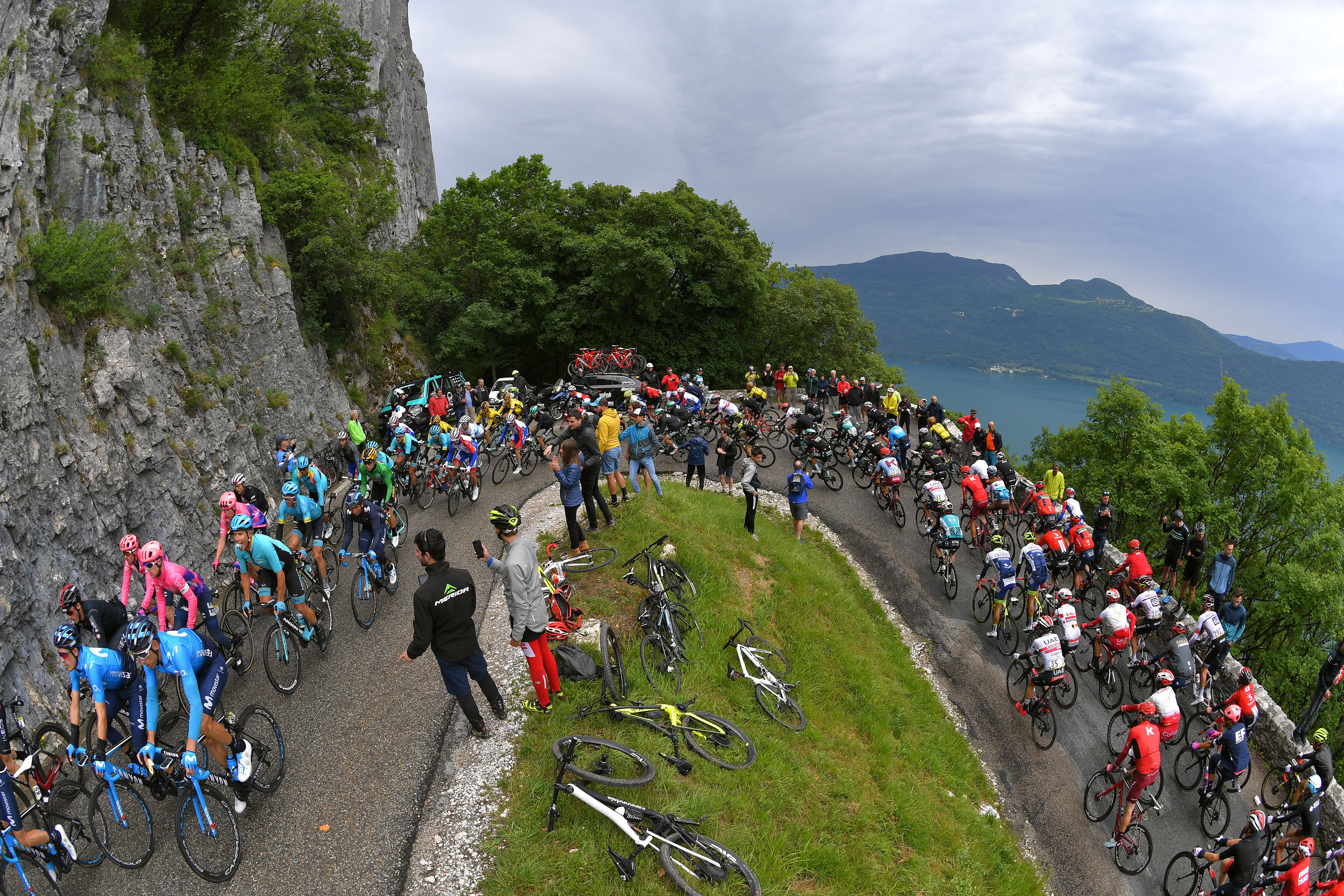 Riders biking up a hill