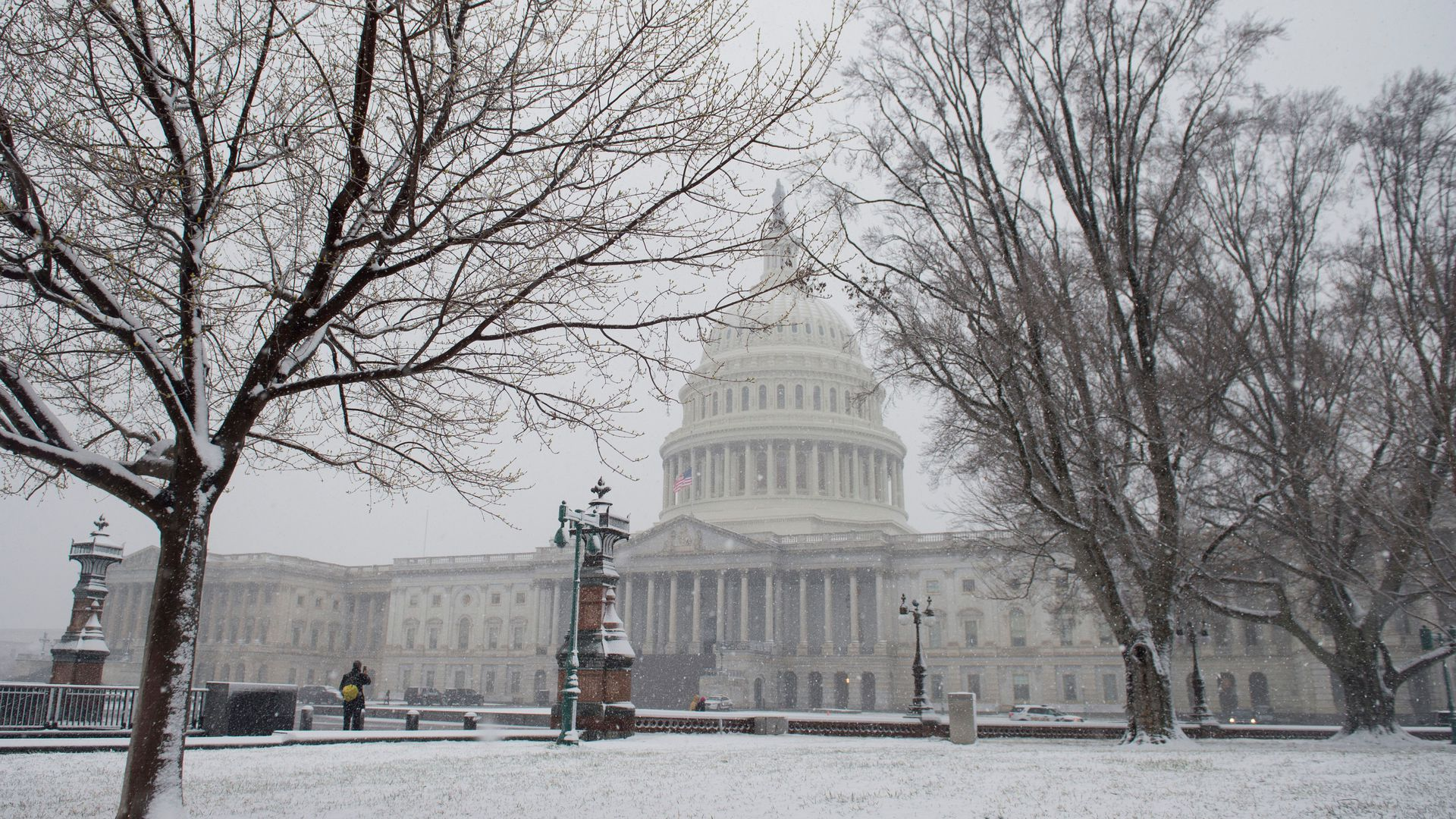 Snow falls on Capitol Hill.