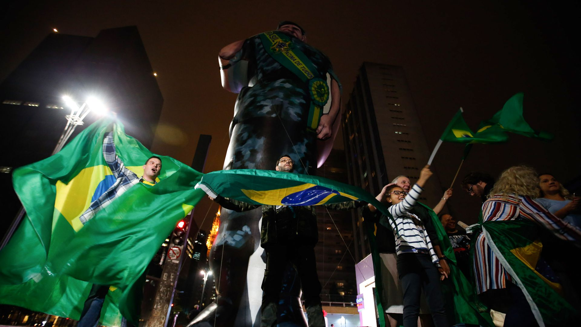 Supporters of Jair Bolsonaro wave Brazilian flags