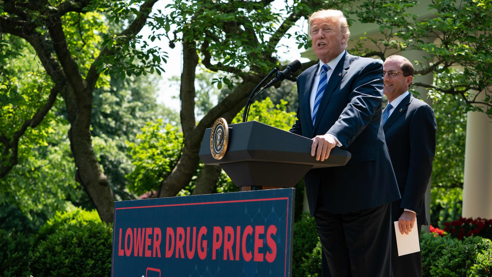 President Trump and Alex Azar discuss a drug price plan in the Rose Garden.