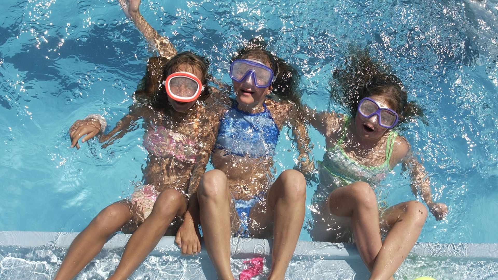 A photo of young girls in a pool