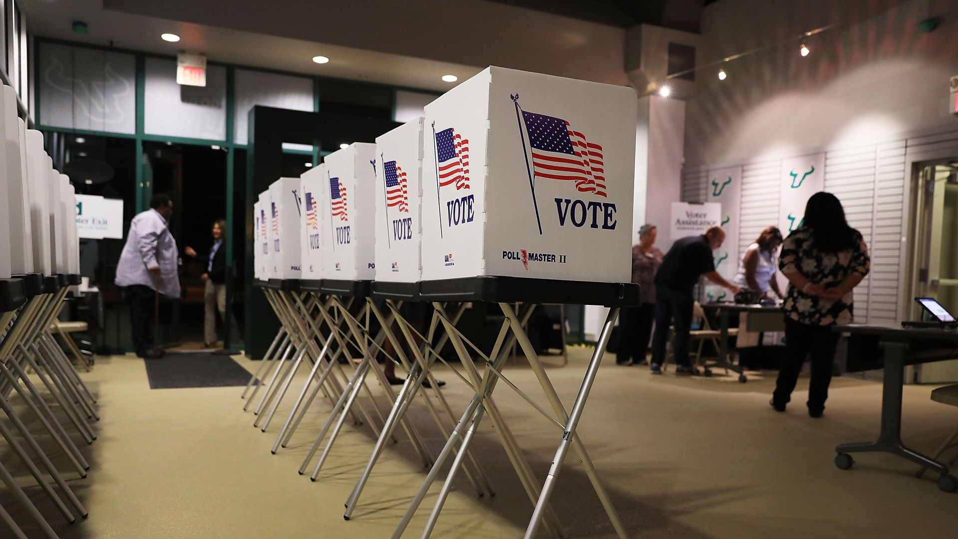 A row of empty voting booths