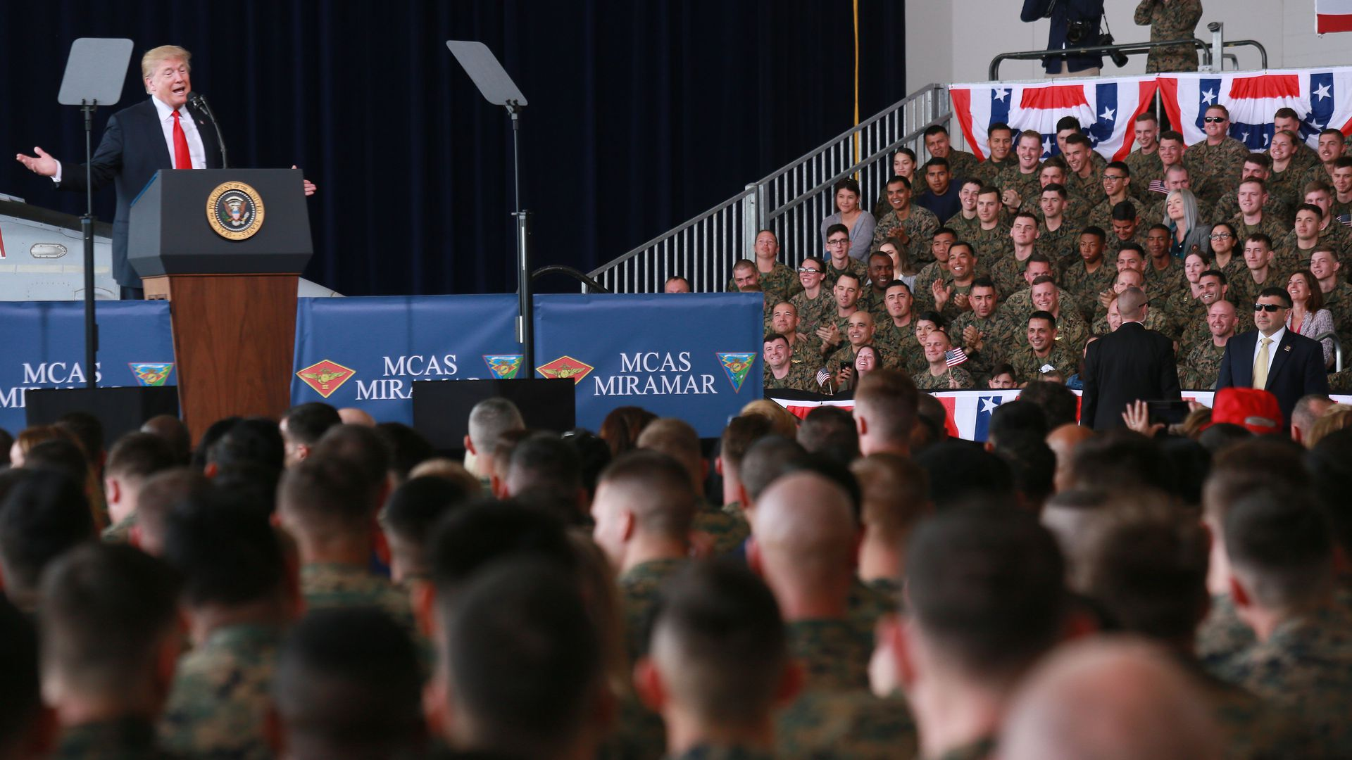 President Trump talks to troops.