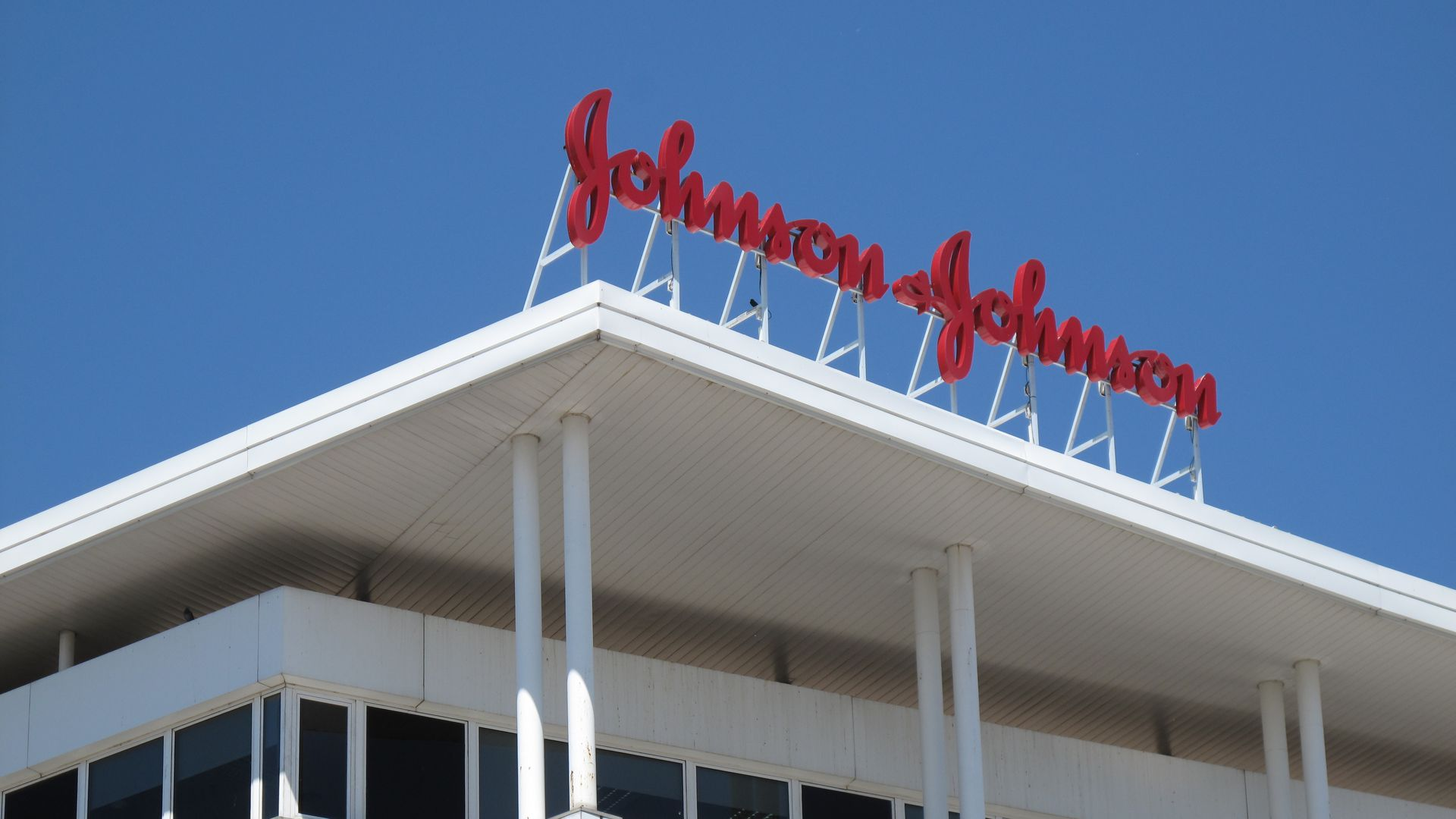 Johnson & Johnson logo on top of a building.