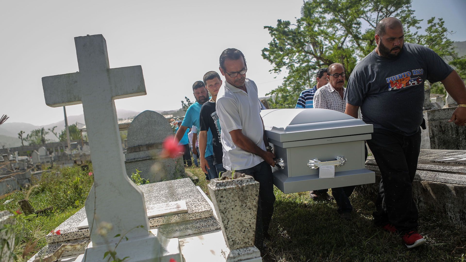 Mourners carry the casket of Wilfredo Torres Rivera, 58, who died October 13 in Puerto Rico following Hurricane Maria.