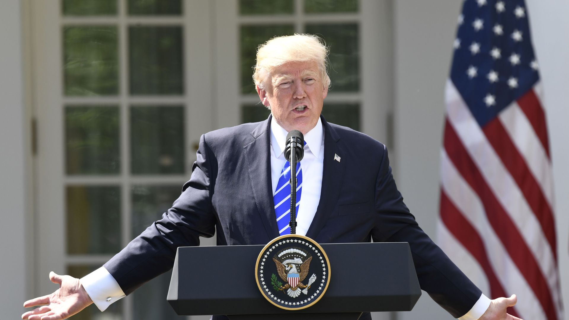 Trump speaking at a press conference