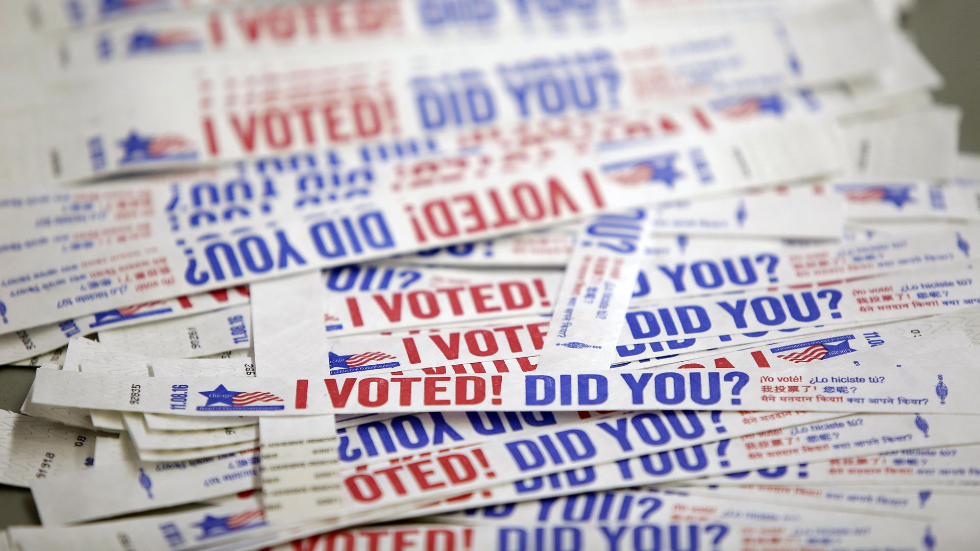 "Stickers reading ""I voted"" in red and blue in a stack"