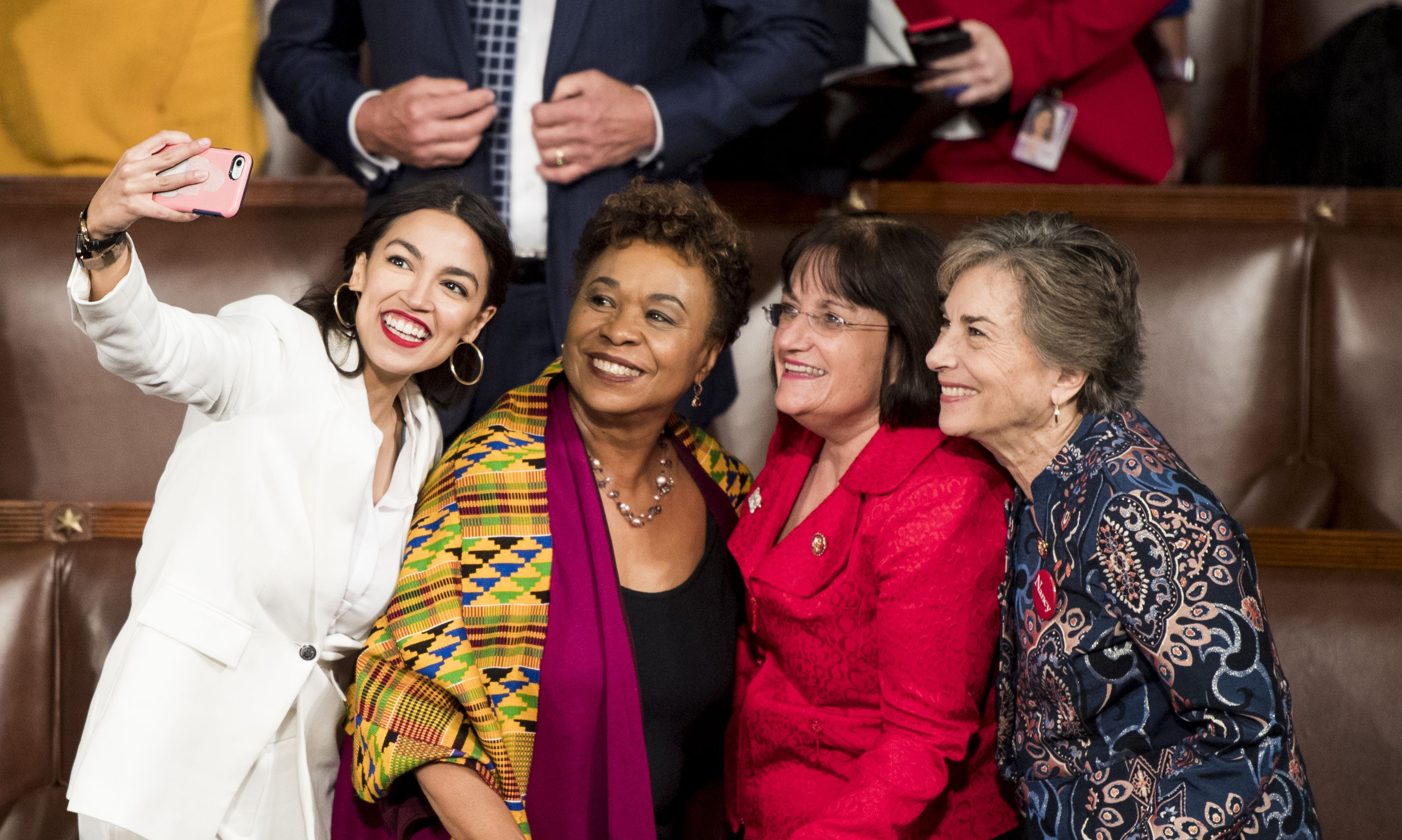 Alexandria Ocasio-Cortez takes a selfie with fellow lawmakers.