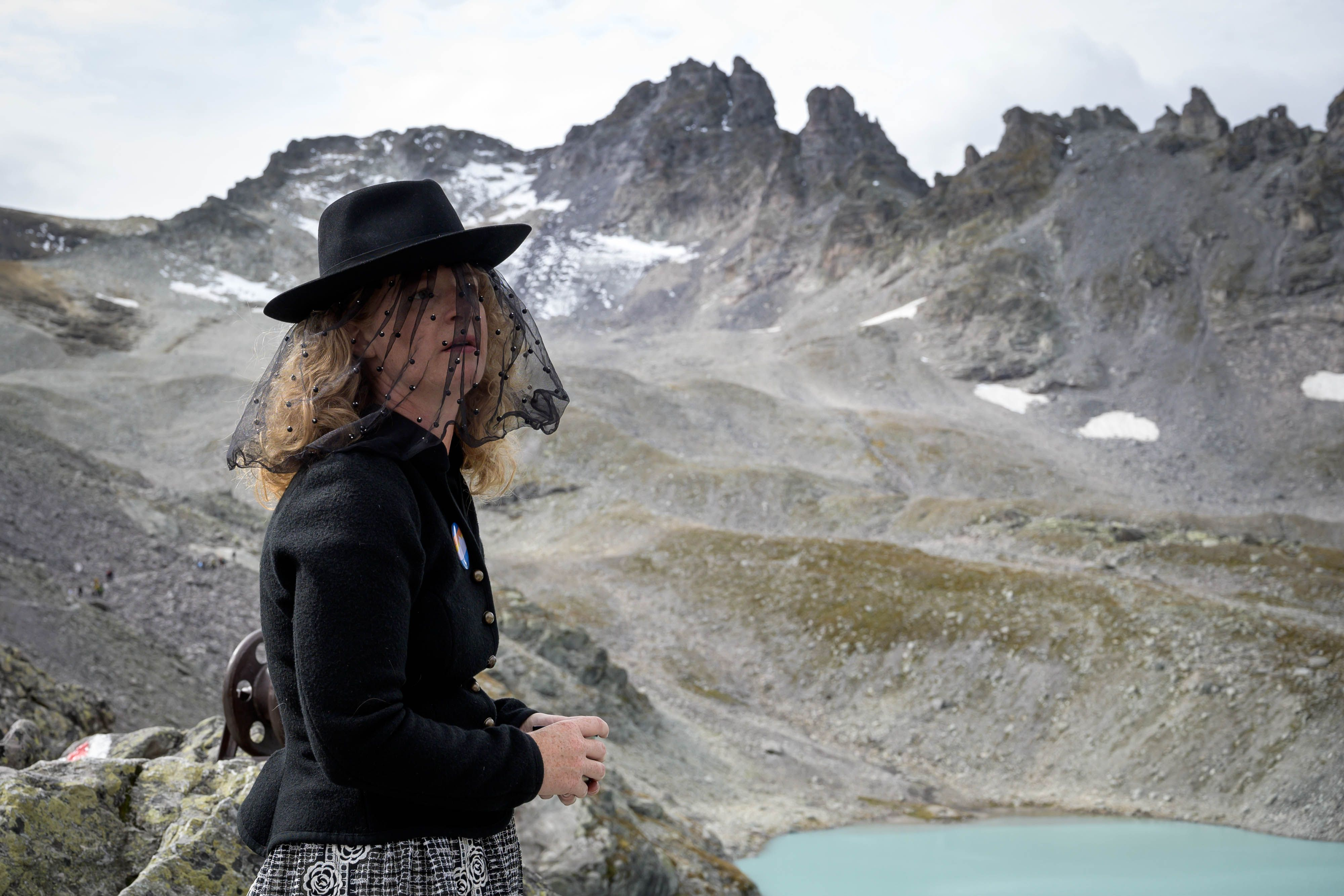In photos: Hundreds mourn Pizol glacier's loss to global warming in Swiss Alps