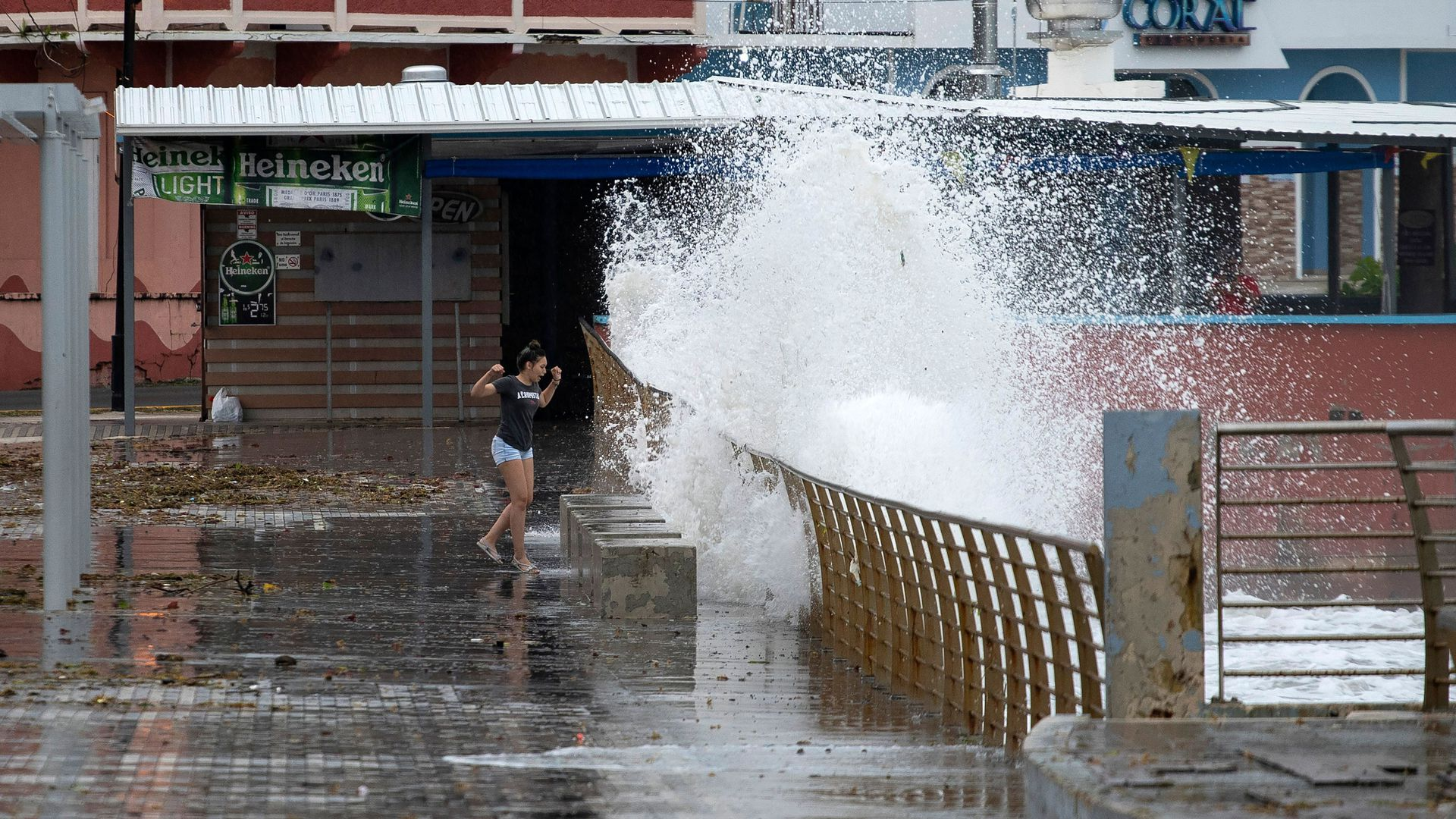 A woman walks next to the coast as tropical Storm Karen approaches in Naguabo, Puerto Rico, on September 24