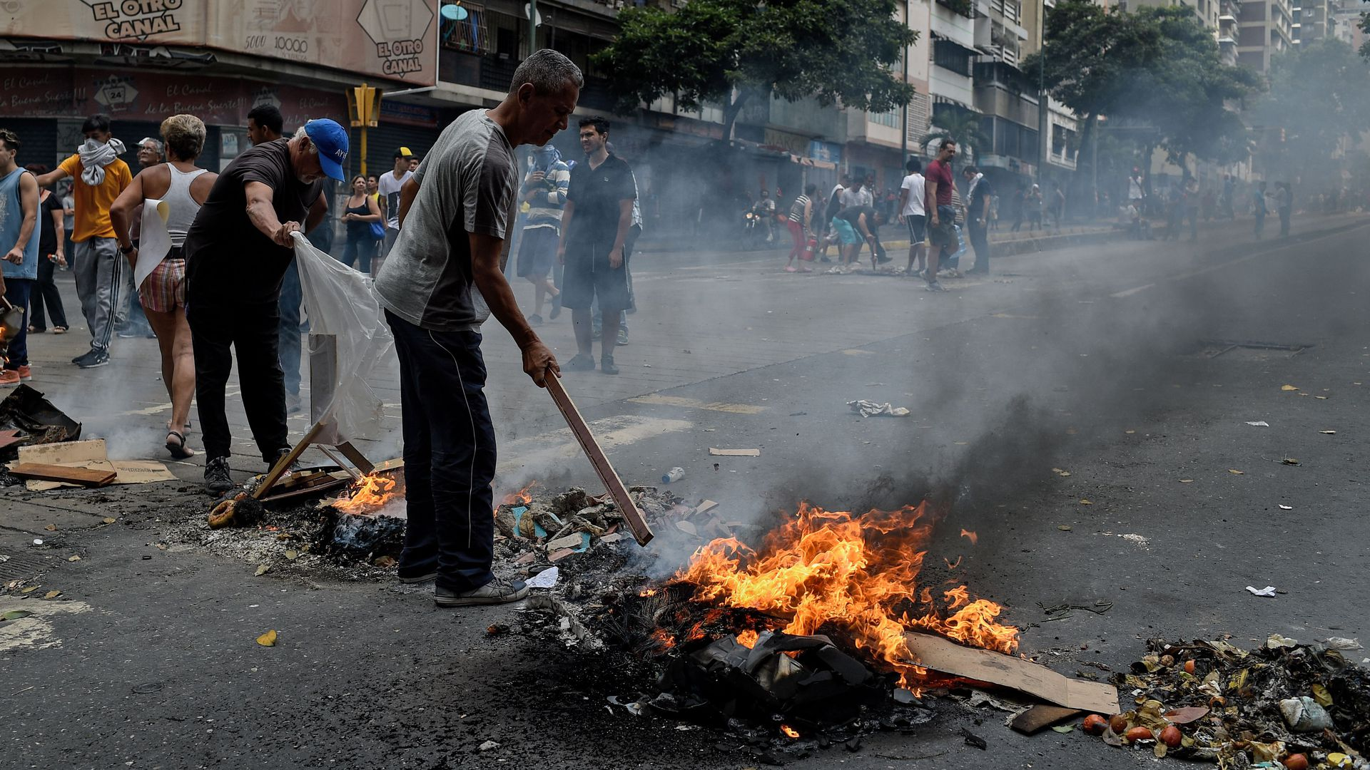 People protest for the lack of water and electric service during a new power outage in Venezuela.