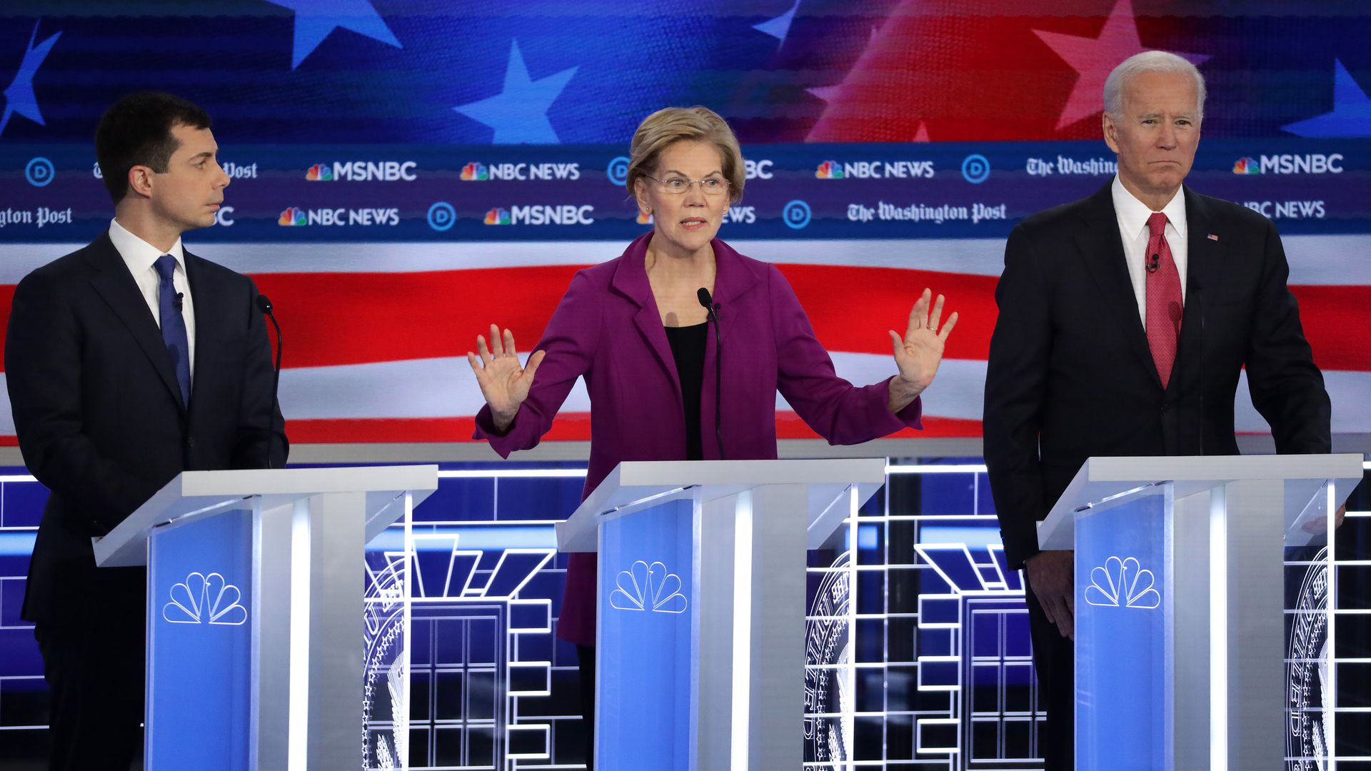 en. Elizabeth Warren (D-MA) (C) speaks as South Bend, Indiana Mayor Pete Buttigieg (L) and former Vice President Joe Biden (R) listen during the Democratic  Debate November 20 in Atlanta