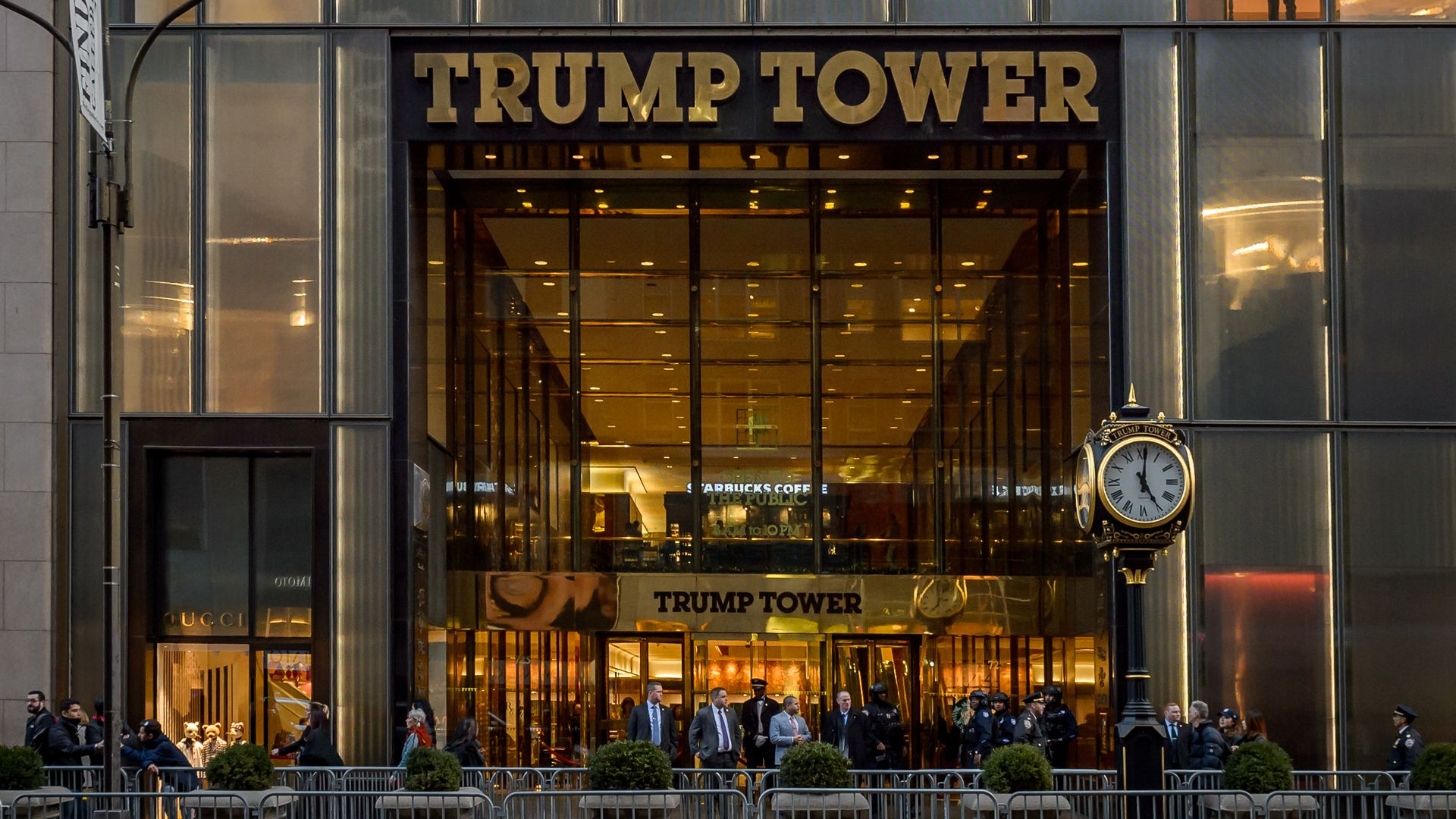 This image shows the front doors of Trump Tower, which are blocked off by concrete barriers.