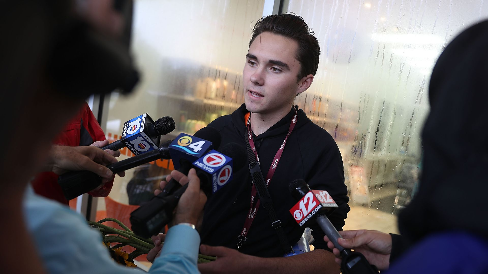 avid Hogg, a survivor of the Marjory Stoneman Douglas High School mass shooting, speaks to the media